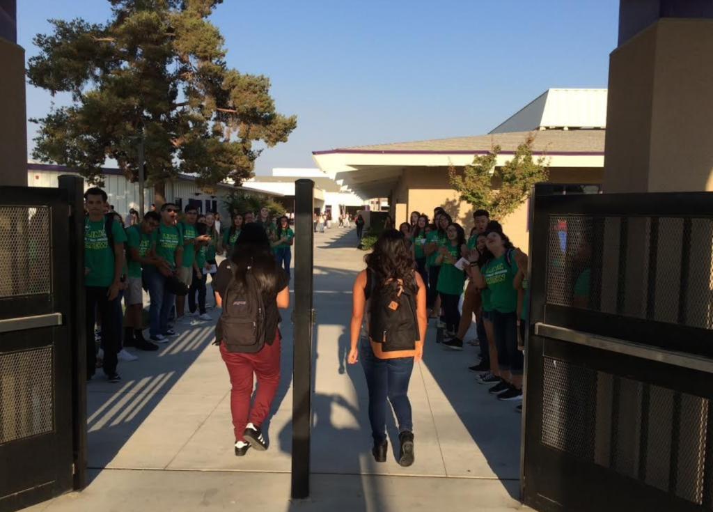 Picture on Right: Link Crew greeting students as they walk on campus. Good job Link Crew and Advisors!